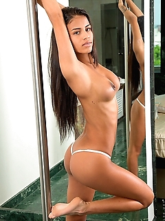 One of the ways that Denisse Gomez keeps herself in shape is by practicing her dance moves on a stripper pole. She makes it even more real by peeling